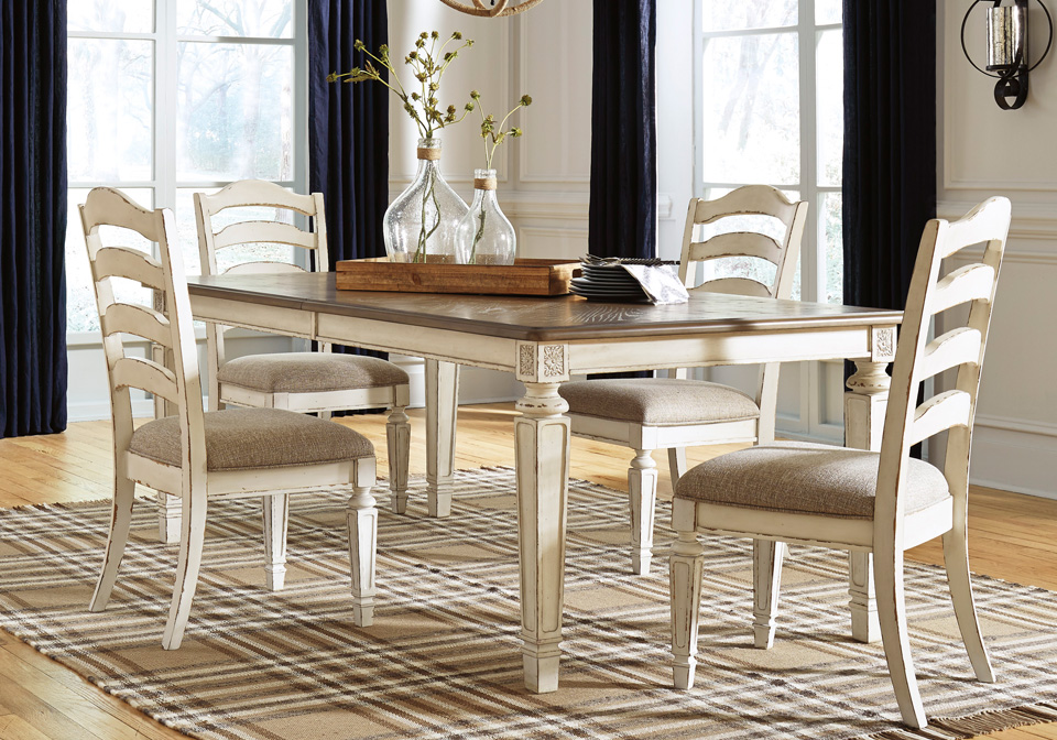 Realyn Chipped Oval Dining Table